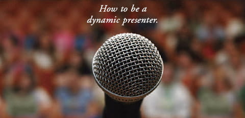 How to be a dynamic presenter -- image shows a microphone in front of an audience.