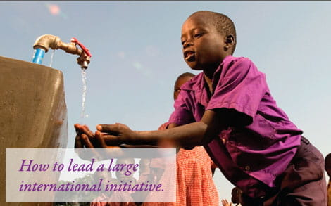A child in Africa getting water from an outdoor tap.