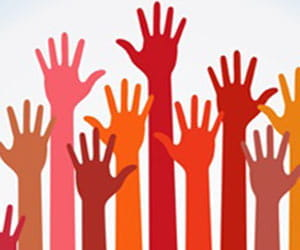 Illustration of many hands of different ethnicities being raised.