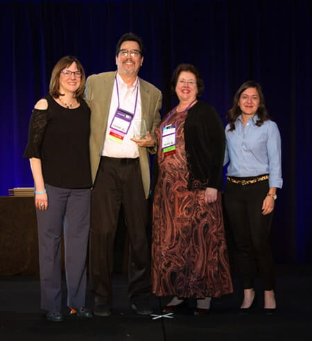 Pictured left to right: Jennifer Rafferty, director of the OLC Institute; Dr. William Schulz III; Dr. Lynn Wilson; and Lynette O'Keefe, director of the OLC Research Center for Digital Learning and Leadership